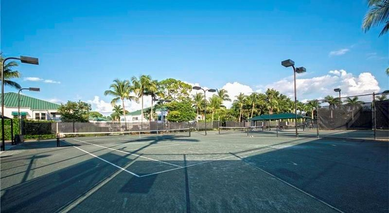 View of the tennis courts at Tarpon Cove in Naples, Florida